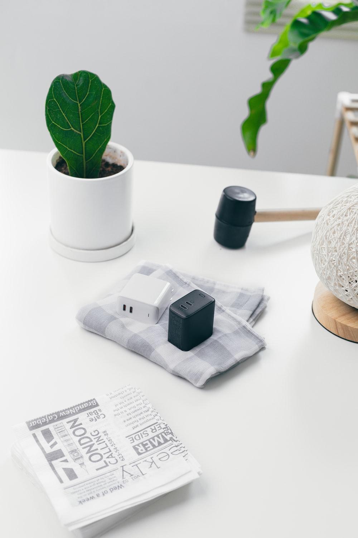 white and black plastic lego blocks beside green plant