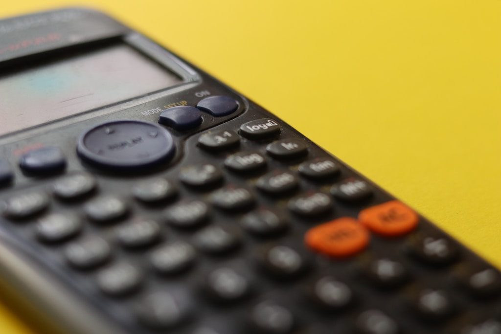 black remote control on yellow surface