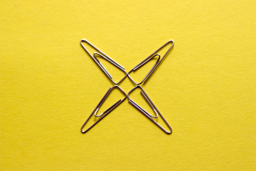 yellow paper clip on yellow surface
