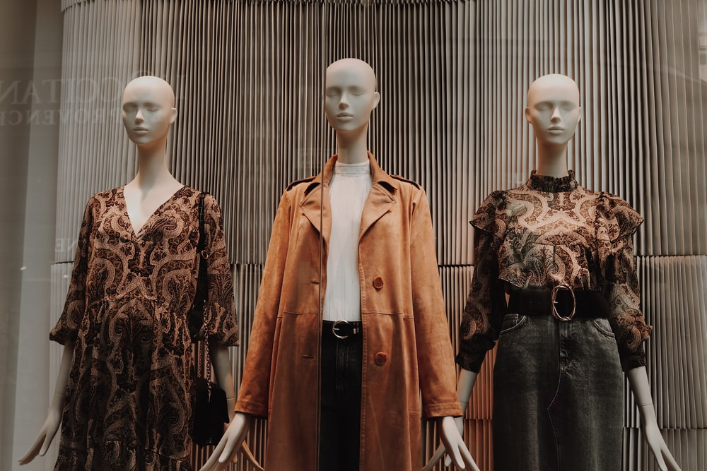 mannequin in brown coat and black skirt
