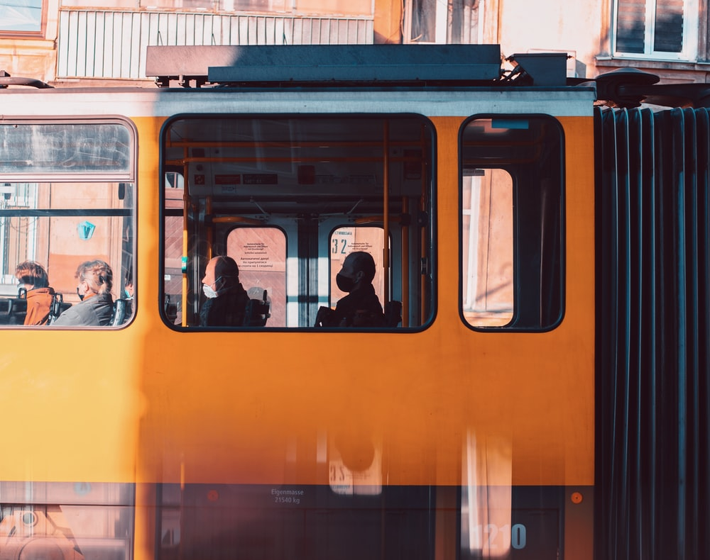 people in train during daytime