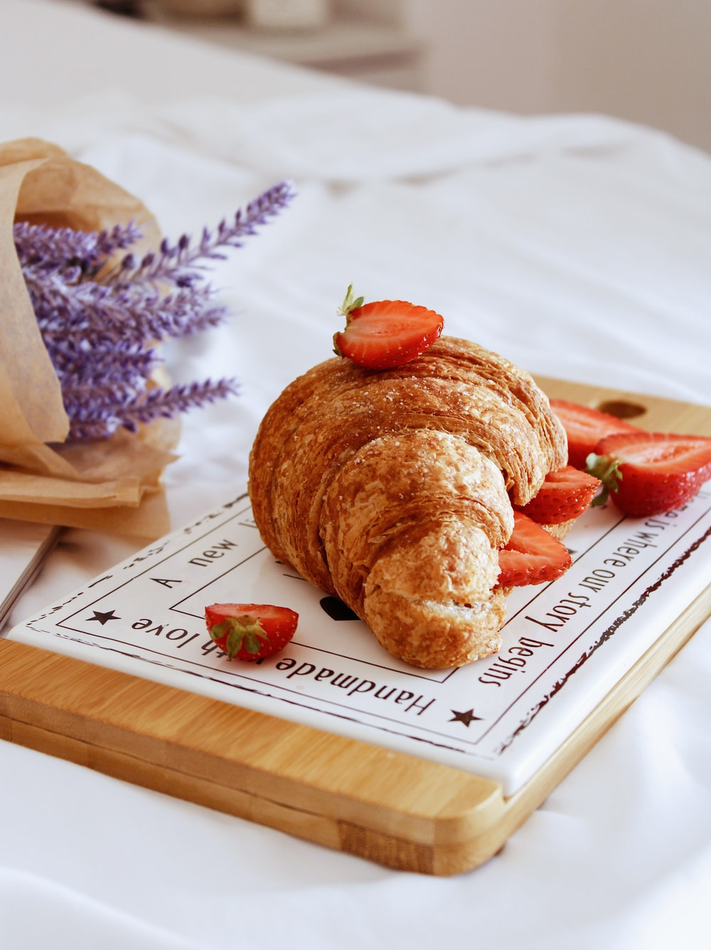 bread on white wooden tray
