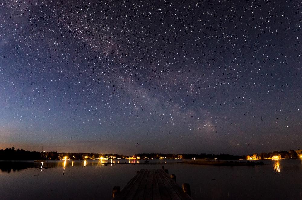 body of water under starry night