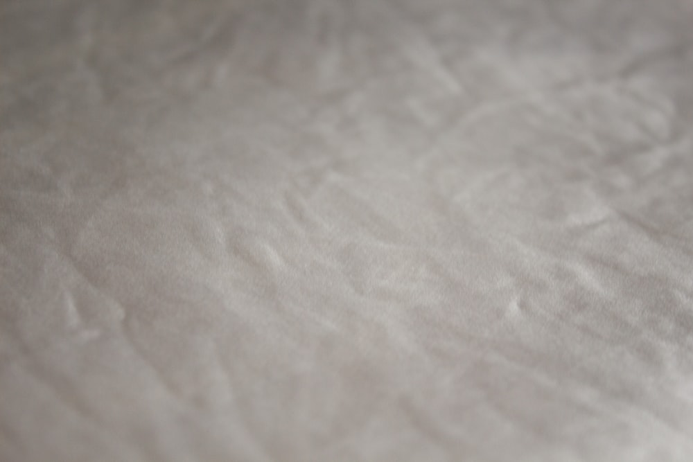 white textile with black hair