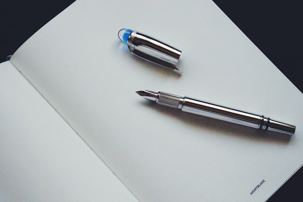 silver and blue click pen