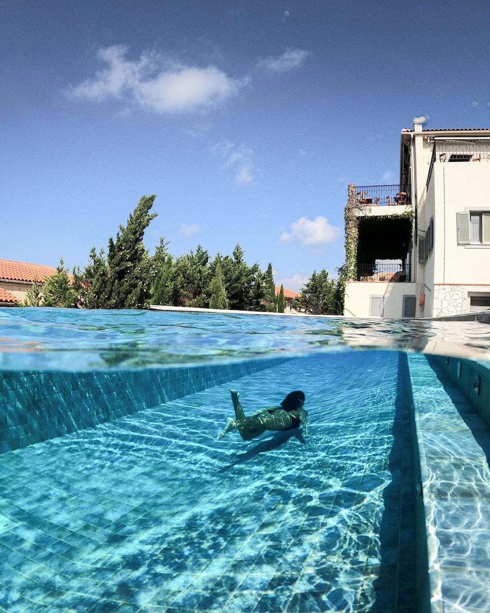 man in swimming pool during daytime