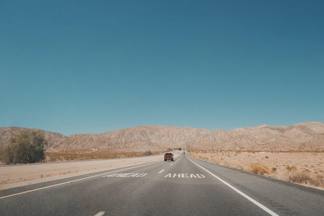 Black Car On Road During Daytime - unsplash