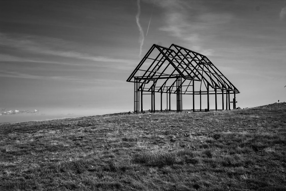 grayscale photo of a metal frame on a field