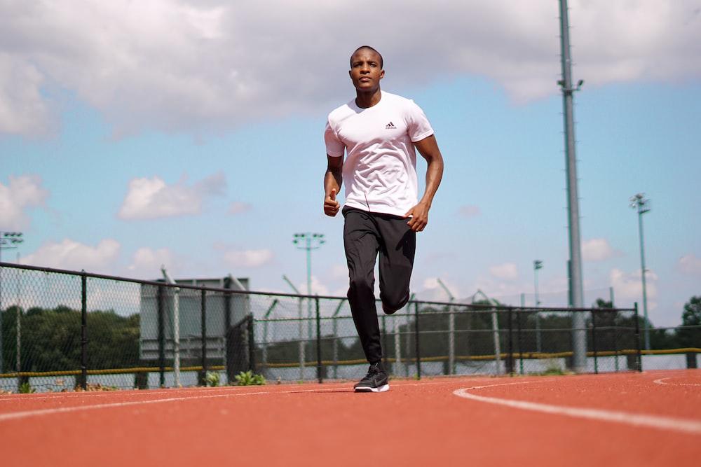 man running on running track fitness exercise