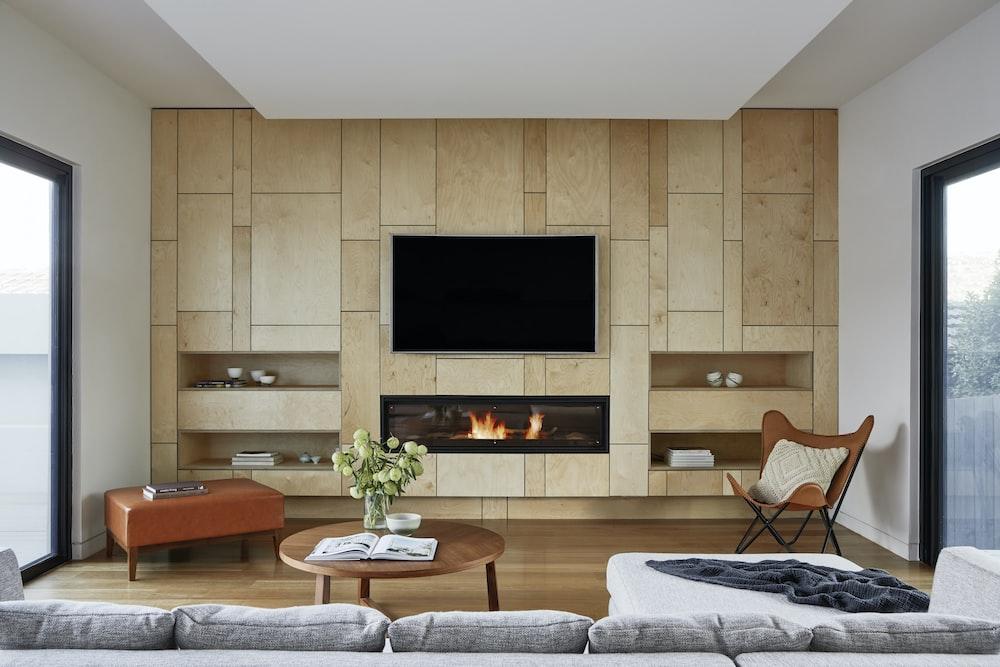black flat screen tv on brown wooden tv rack