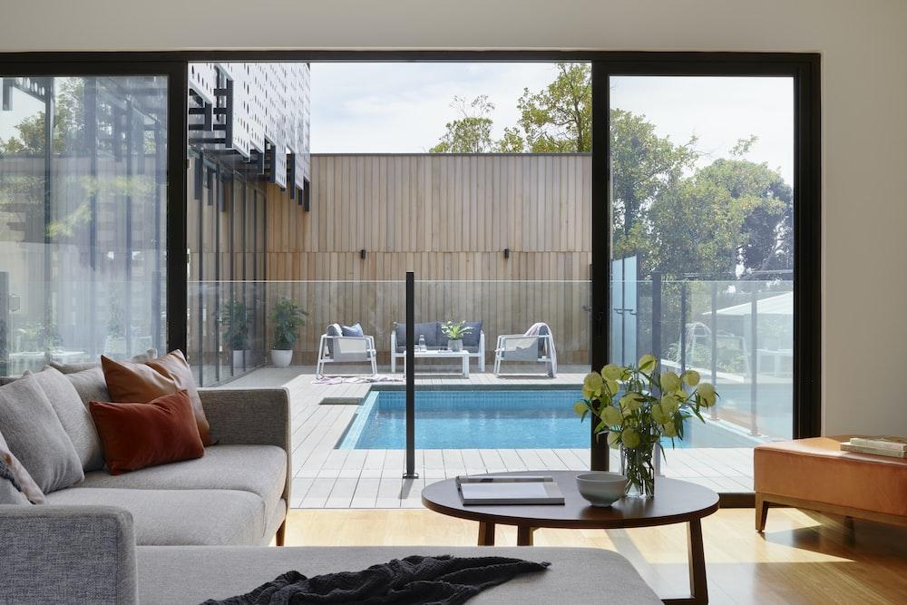 brown sofa near glass window