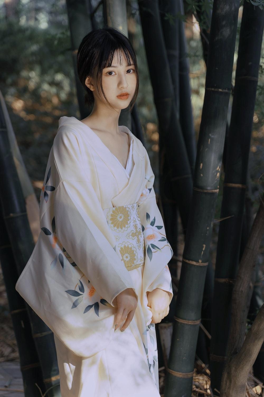 woman in white and yellow floral kimono
