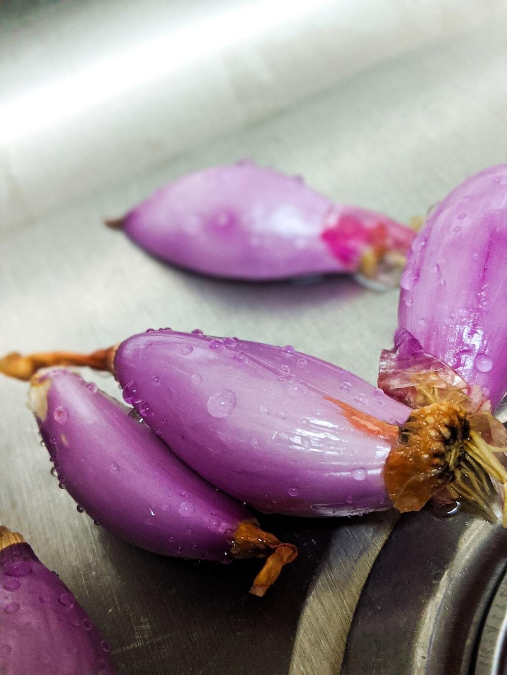purple flower petals on brown wooden table