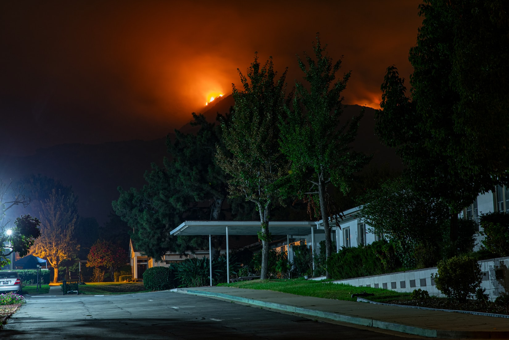 Neighbors Spread the Word to Slow the Destructive Spread of Fires