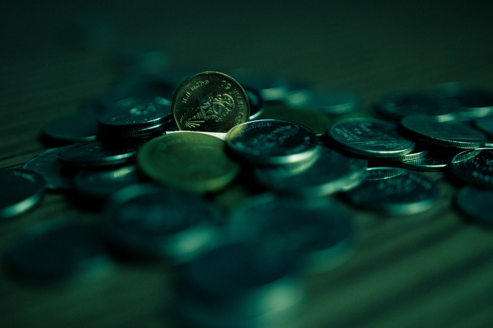 silver round coins on blue surface