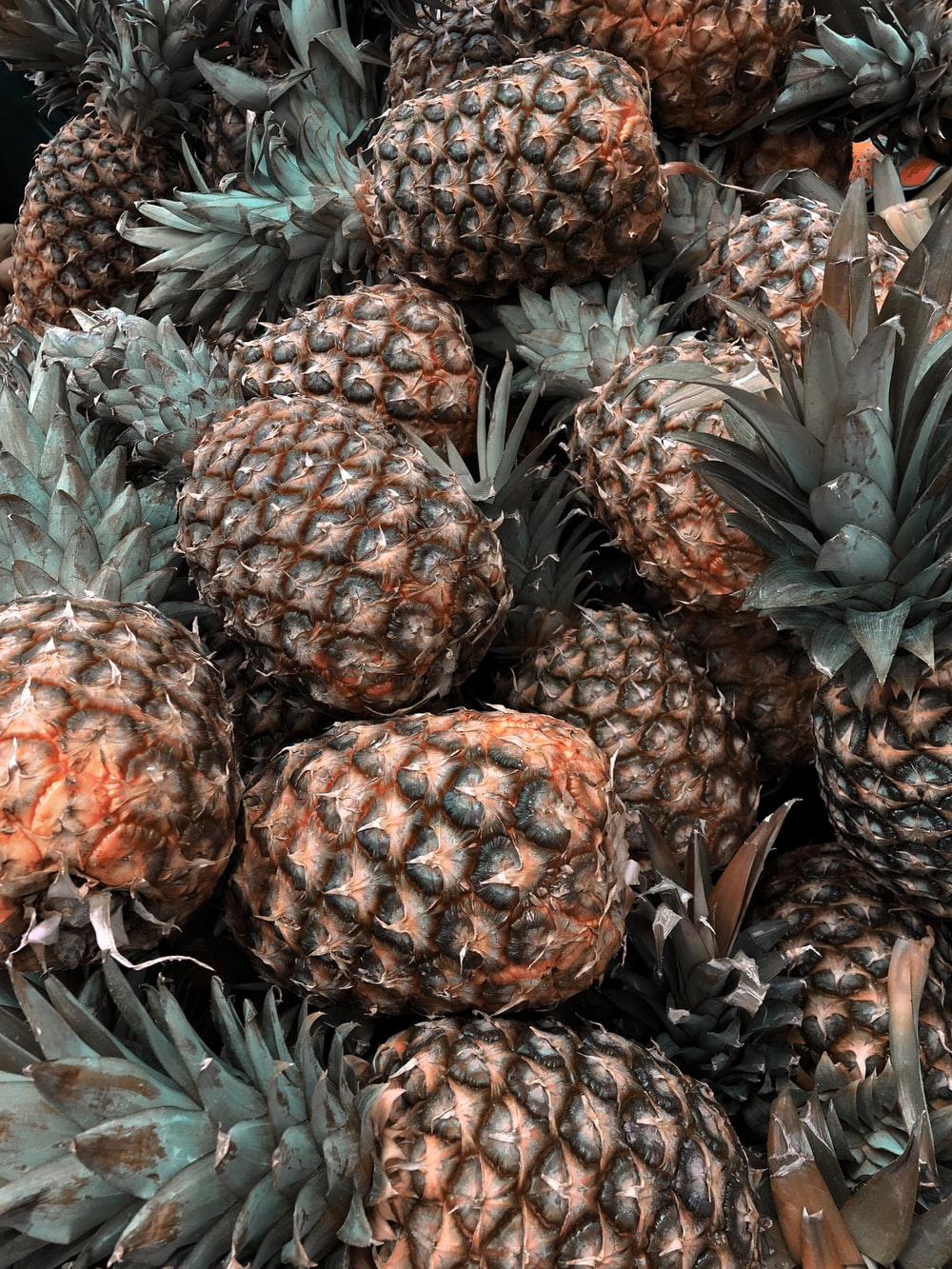 green and brown pineapple fruits
