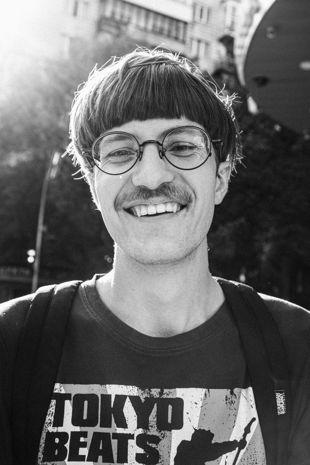 grayscale photo of man in crew neck shirt and eyeglasses