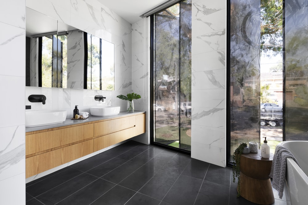 white ceramic sink near white framed glass window