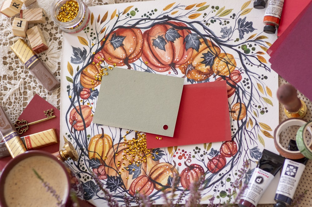 red rectangular box on white and blue floral round plate