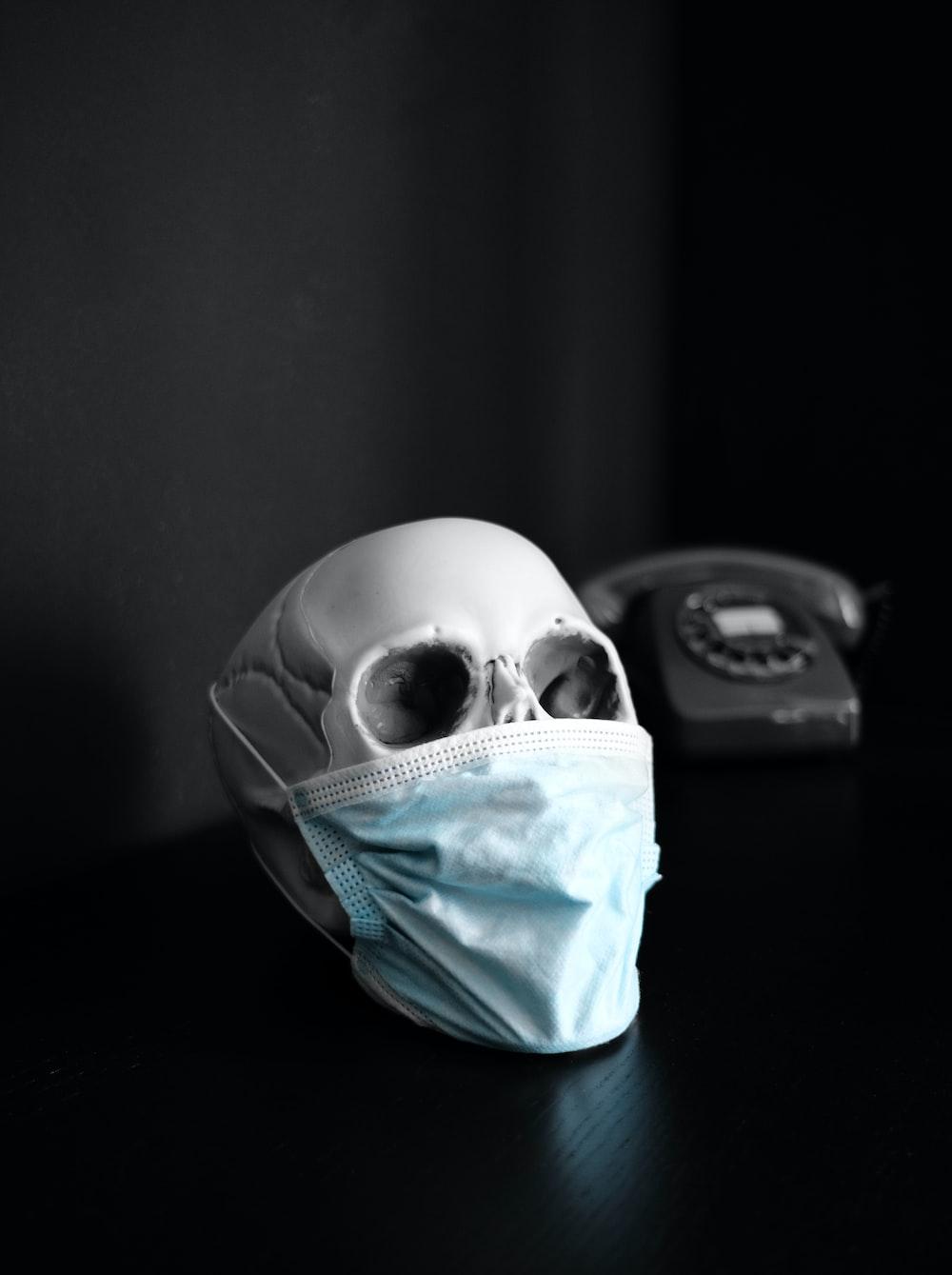 white and blue skull on black surface