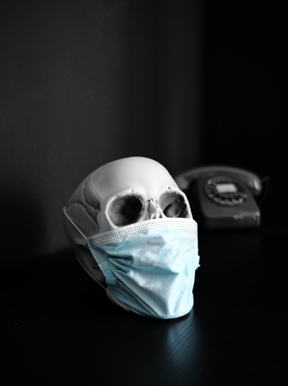 white and blue skull on black surface