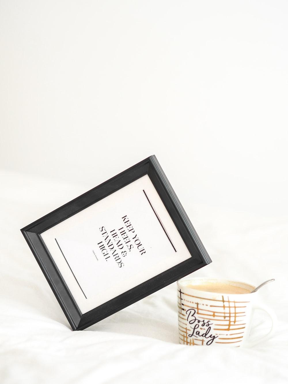 black wooden frame with white printer paper