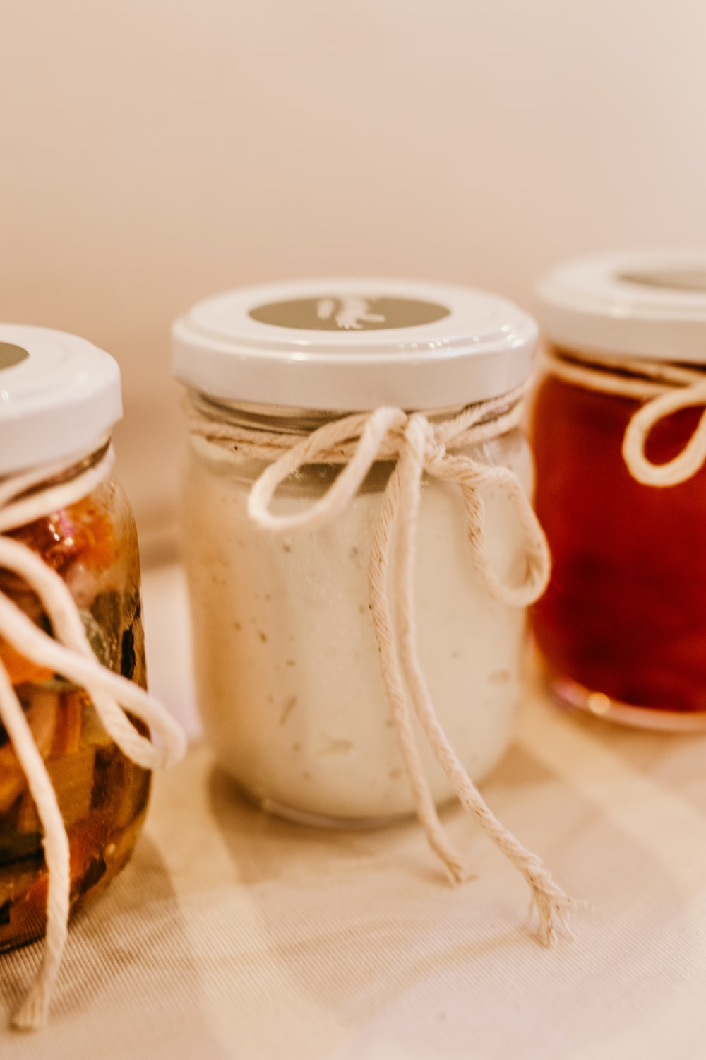 white and brown glass jars