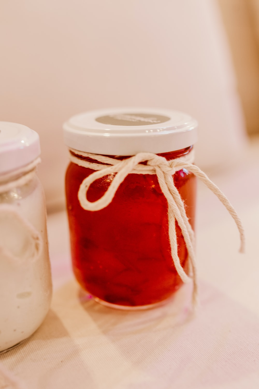 clear glass jar with red liquid