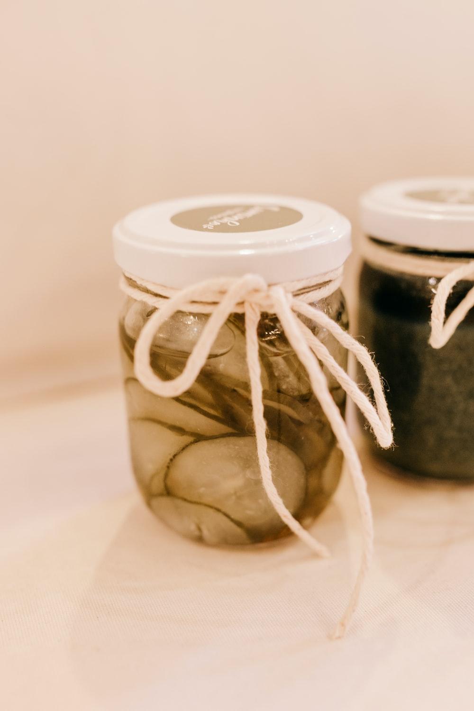 white and green ceramic jar