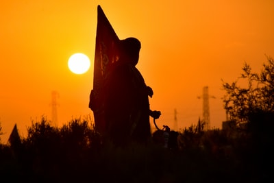 silhouette of man riding horse during sunset iraq teams background