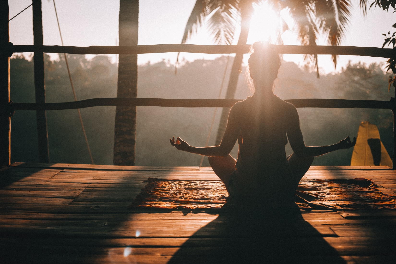 Person meditating in the sunlight