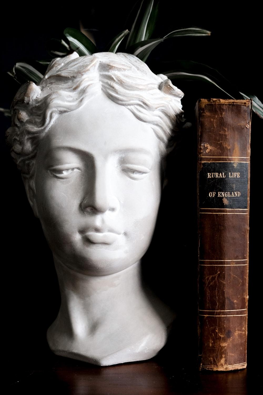 white ceramic woman bust figurine