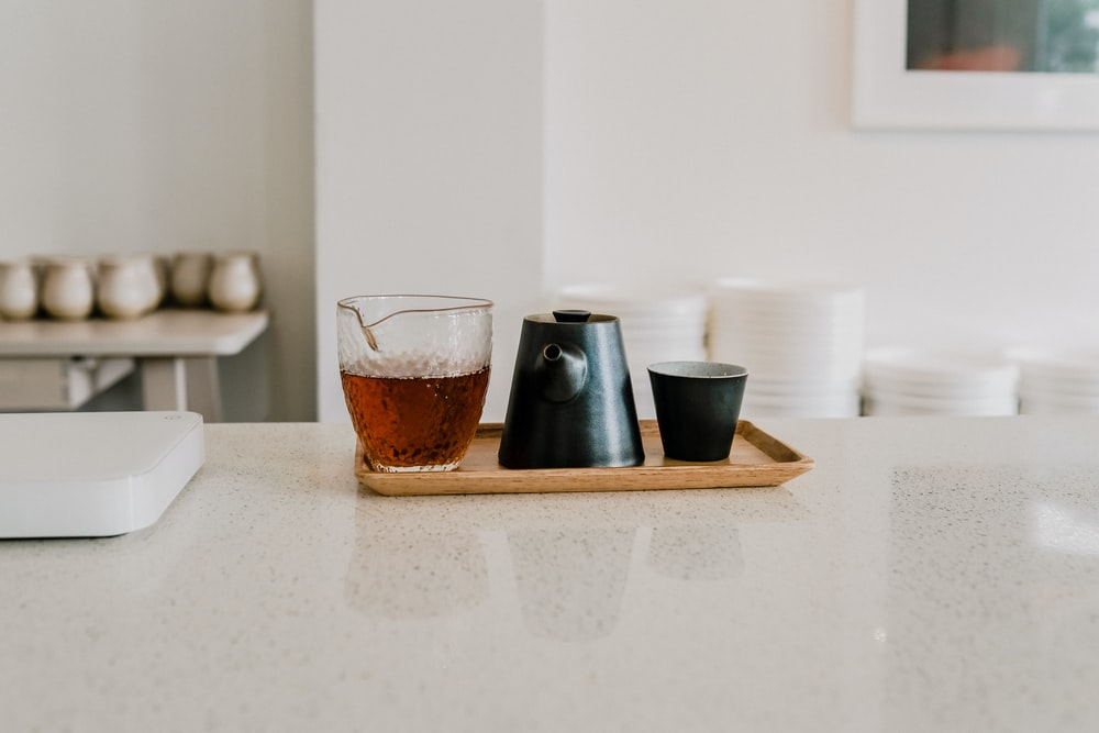 2 clear drinking glasses on white table