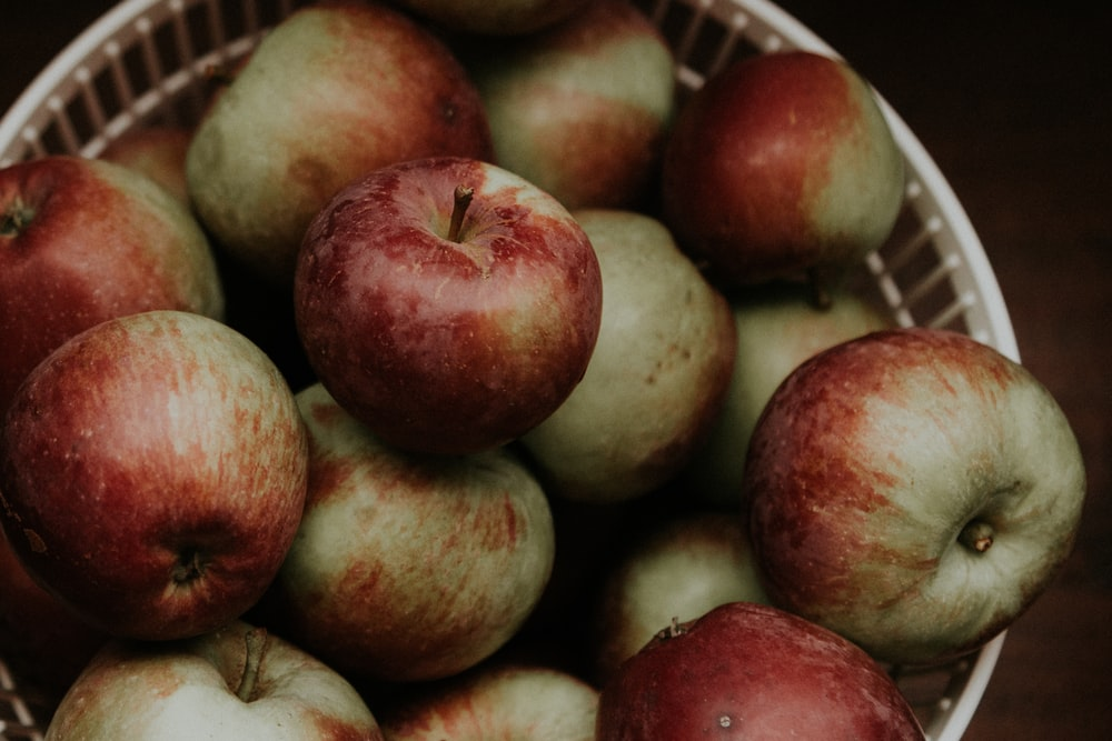 red apples on white plastic container