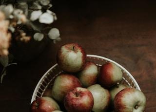 red apples on white ceramic bowl