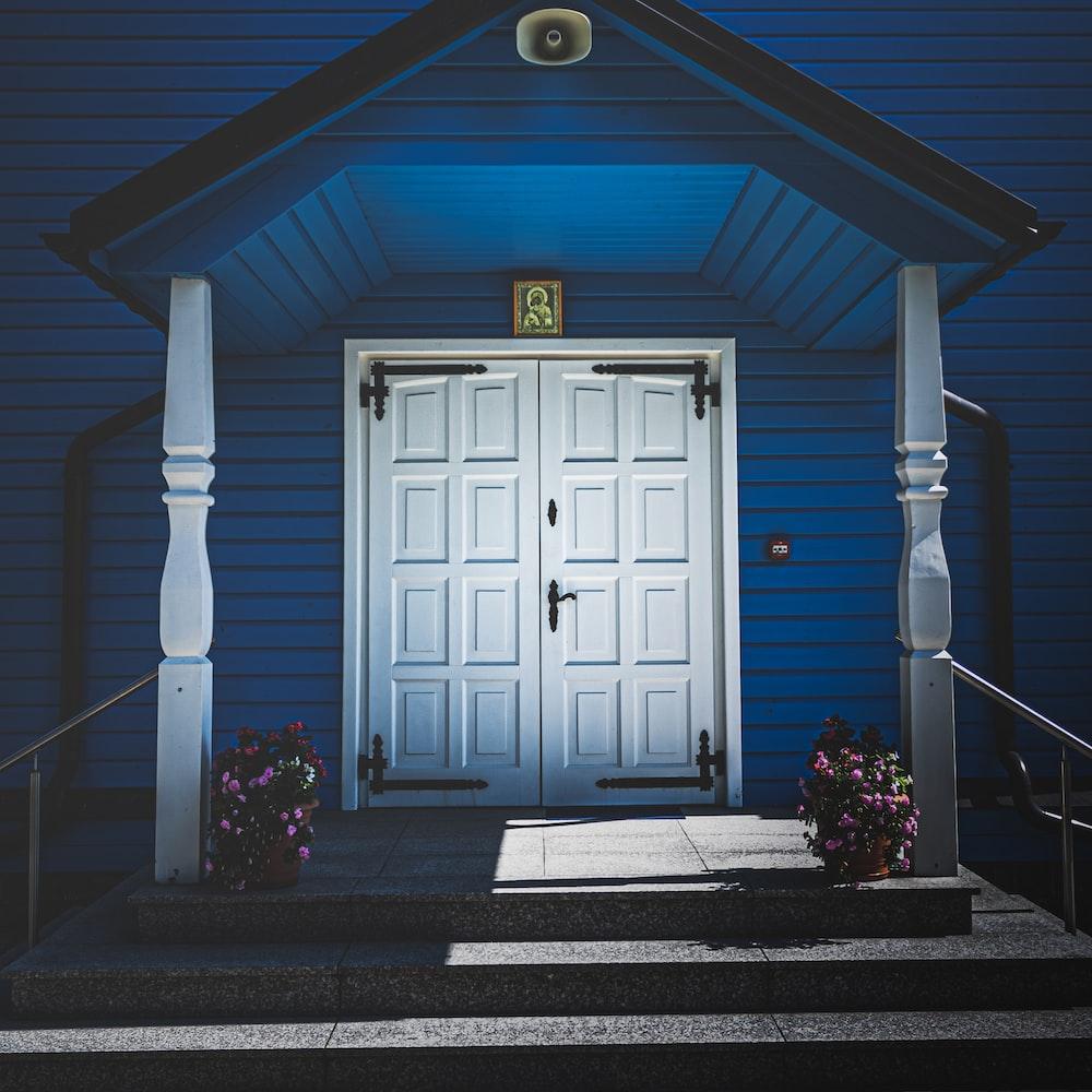 white wooden door with black steel door knob