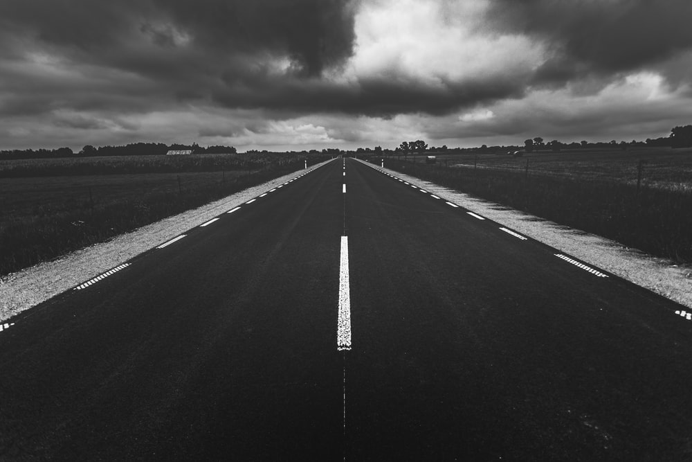 grayscale photo of empty road