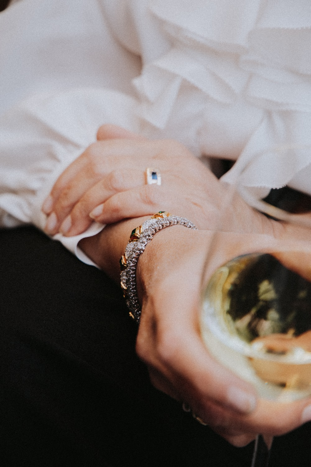 person wearing silver and gold ring