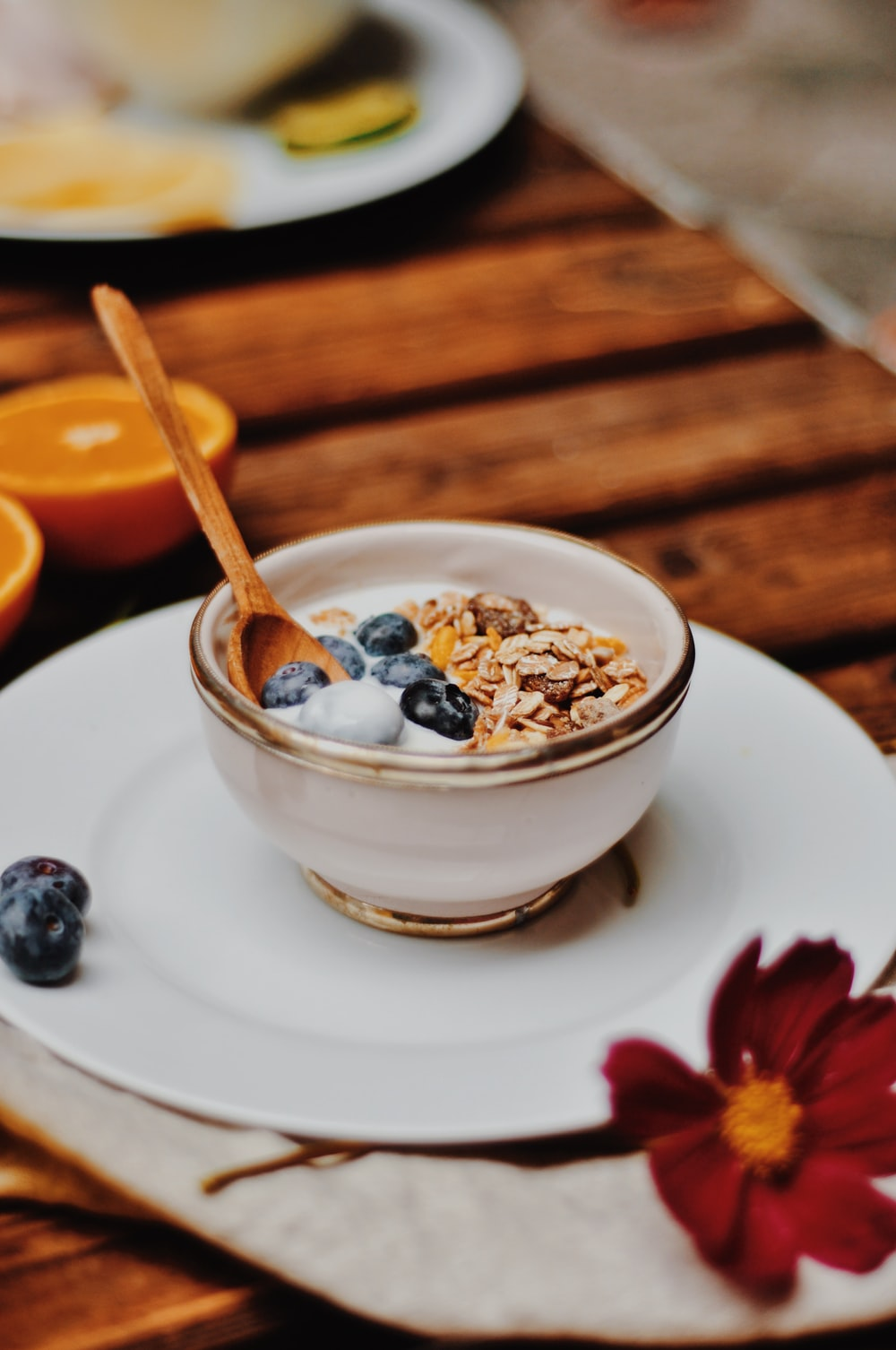 white ceramic bowl with cereal and spoon