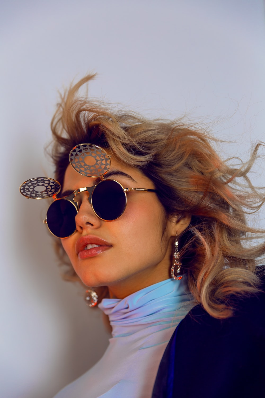 woman in gold framed aviator sunglasses