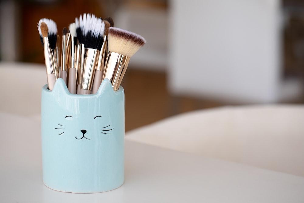 white ceramic mug with brush