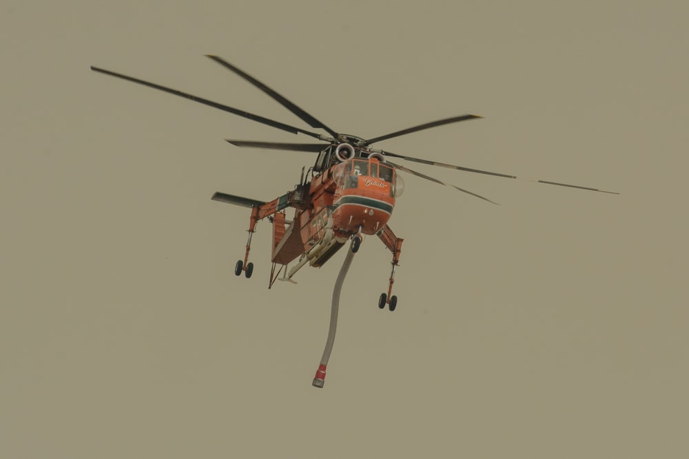 orange and black helicopter flying