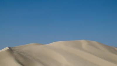 white sand under blue sky during daytime nevada zoom background