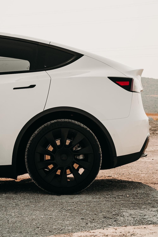 white car on gray concrete road