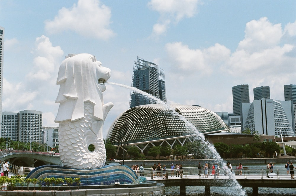 white concrete statue near city buildings during daytime