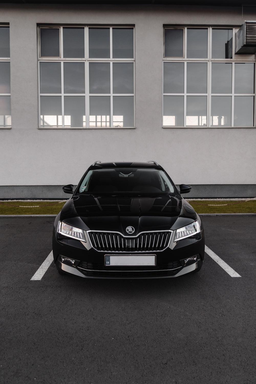 black bmw car parked on parking lot
