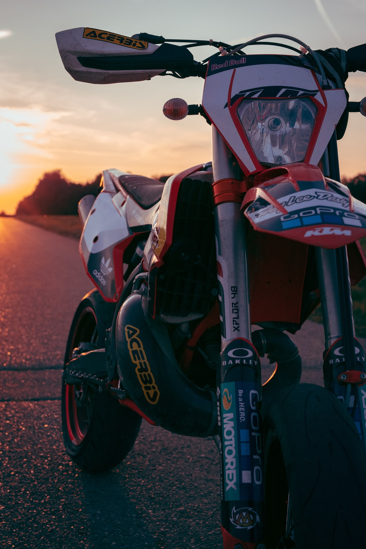 red and white sports bike