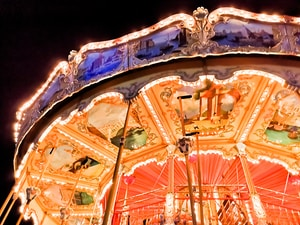 people riding on a carousel during night time