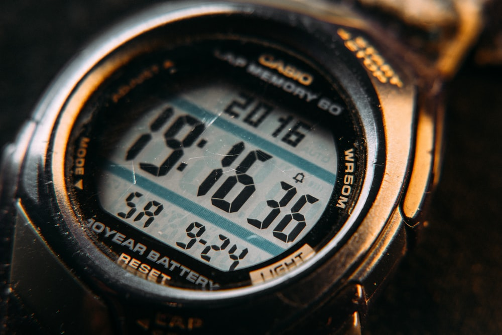 black and gray digital watch at 10 00