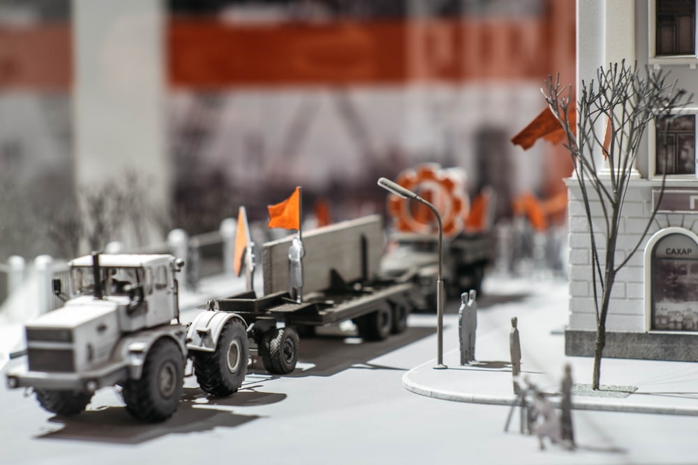 black and white utility trailer with orange and white traffic cone